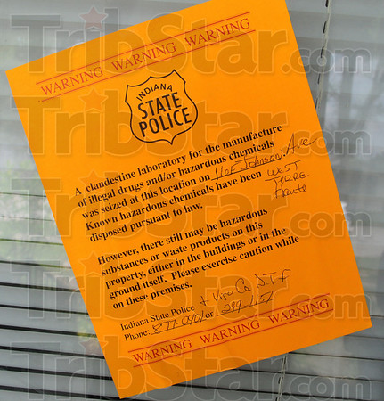 Greetings: A warning poster warns visitors of the dangers within a residence at 16 E. Johnson Avenue in West Terre Haute.