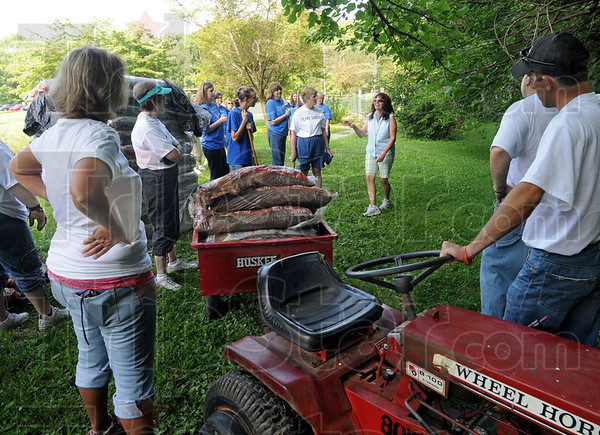 Instructions: Volunteers receive instructions on the spreading of mulch on trails in Dobbs Park Friday morning as part of the United Way's Day of Action.
