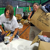 United: Tamra Inman (L) and Courtney Zellars sort clothing at the West Terre Haute Community Center Friday morning as part of the United Way's Day of Action.