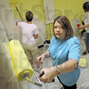 Paint party: Jacquie Stepp (center), Lori Leo (L) and Karen Harding paint the kitchen area of the Washington Community Center Friday morning. They are participating in the United Way's Day of Action.