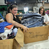 Sort team: Courtney Zellars and Tamra Inman sort clothing at the West Vigo Community Center Friday as they volunteer their time for the United Way's Day of Action event.