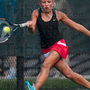Tribune-Star/Joseph C. Garza<br /> This one is not getting away: Terre Haute South's Taylor Bullock chases down a return by Highland's Aby Madrigal during their No. 2 singles state tennis quarterfinals match Friday at Park Tudor High School.