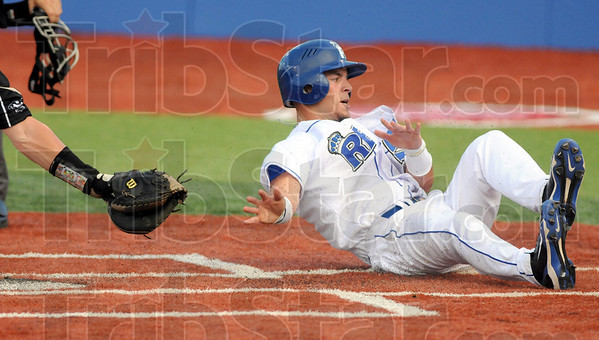 Score: Terre Haute Rex third baseman Koby Kraemer scores around the tag of the catcher during the fourth inning Friday night.
