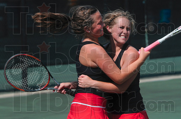 "Tribune-Star/Joseph C. Garza<br /> No. 2 ""dubs"" does it: Terre Haute South No. 2 doubles teammates Jacqualynn Bogle and Lexi Summers celebrate their state tennis quarterfinals victory over Highland Friday at Park Tudor High School."