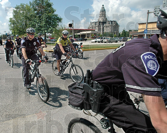 Bike escort: Indiana State University bike patrol officers ride escort for the Indiana Special Olympc Torch as it arrives on campus Friday morning.