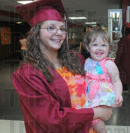 peaker: Kathryn Rose Dean was one of two student speakers at the Booker T. WashingtonCommencement exercises Friday night. She is holding her 14-month-old daughter Olivia.