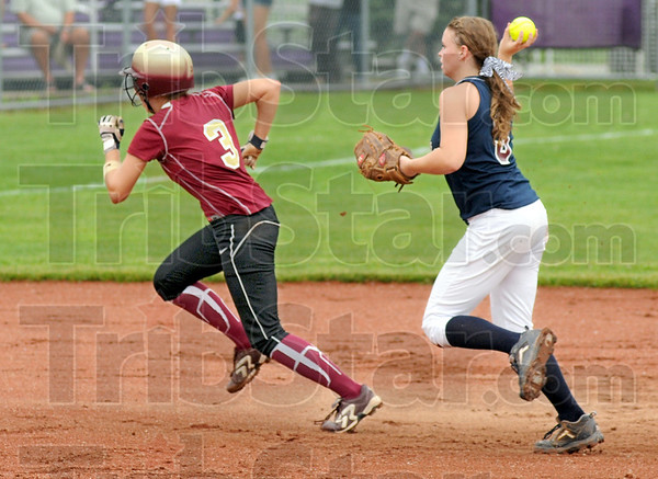 Rundown: Lutheran's #3, Hailey Reed attempts to outrun Riverton Parke's #3, Sarah Burnham during Saturday's championship game. Reed made it safely to third base on the play.