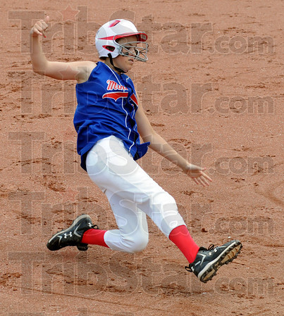 In there: Linton's #45, Joie Gadberry slides into third base during the second inning of Satuday's championship game.