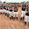 Champs: Riverton Parke softball players watch the presentation of the mental attitude award after winning the State Softball Class A Championship Saturday afternoon.