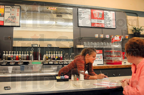 Tribune-Star/Joseph C. Garza<br /> Good old fashioned customer service: The Newsstand waitress Kela Gilham takes customer Cindy Cox's lunch order at the restaurant's counter May 20 in Sullivan.