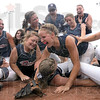 Ground game: Members of the Riverton Parke softball team dive onto a teammate on the field after winning the Class A State Softball Championship.