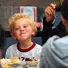 Tribune-Star/Joseph C. Garza<br /> It'll put a smile on your face: Two-year-old Cooper Bock eats a bite of cake as he enjoys lunch with Dru Lisman, Cara Demoss and Judy Badger May 20 at The Newsstand.