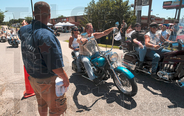 Tribune-Star/Joseph C. Garza<br /> And, they're off: Motorcyclists take off from the parking lots surrounding Wabash Valley Harley Davidson to participate in the 2010 Mayor's Ride Saturday off of US 41. About 357 riders raised money for the Terre Haute Humane Shelter.