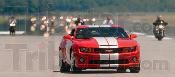 Tribune-Star/Joseph C. Garza<br /> 2010 Camaro SS in the lead: Mayor Duke Bennett rides as a passenger in an Indianapolis 500 pace car as it leads participants in the 2010 Mayor's Ride on a runway at the Terre Haute International Airport Saturday.