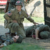 Enemy: An American medic gives aid to two wounded German soldiers during Saturday's re-enactment at Billie Creek Village.