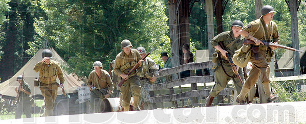 Advancing: American troops advance during war games with German soldiers at Billie Creek Village Saturday afternoon.