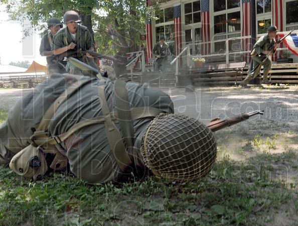 """Cost of war: An American soldier gets """"hit"""" during war games at Billie Creek Village Saturday afternoon."""