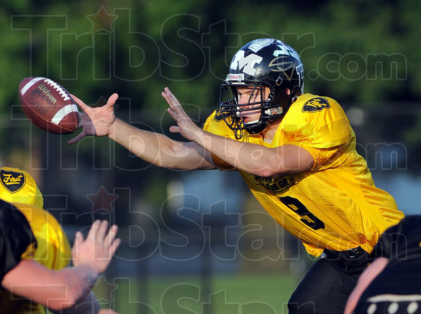 Get a grip: South Vermillion quarterback Andy Walsh hauls in a snap from center during Saturday's WVFCA all-star game.