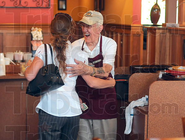 Tribune-Star/Joseph C. Garza<br /> More than just pie and free Wi-Fi...: There's also Bill Dunn, an 86-year-old bus boy who is just as popular as the baked goods and free Internet connection. Here, Bill receives a hug from customer Debbie Diethrich as congratulations for Bill's new great-granddaughter.