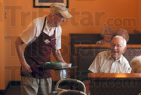 Tribune-Star/Joseph C. Garza<br /> Making lunch a little brighter: Bill Dunn shares a laugh with a couple as he takes away their finished plates during the lunch hour Wednesday at Grand Traverse Pie Company.