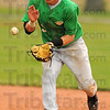 Sure hands: Thunderbird shortstop A.J. Boyll gloves a groundball in action against Oldenburg Academy in the semi-final round of the baseball regional at Shakamak Saturday morning.