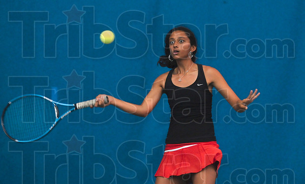 Tribune-Star/Joseph C. Garza<br /> Eyes on the prize: Terre Haute South's Eesha Purohit returns a forehand to her Columbus North opponent during their No. 1 singles state tennis semifinal match Saturday in Indianapolis.
