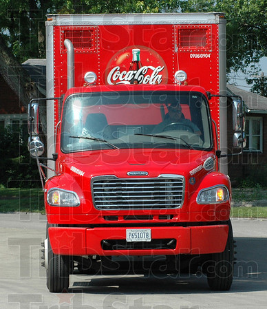 New fleet: A driver returns empty to the Coca Cola distribution center after making his daily rounds Tuesday.