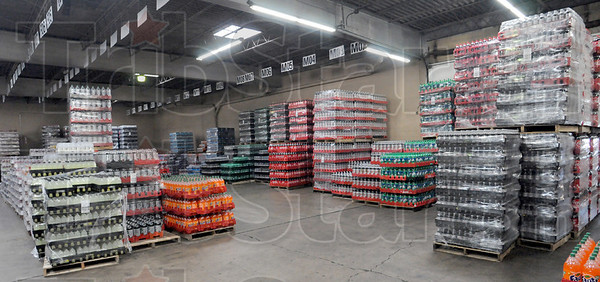 Inventory: The warehouse of the Coca Cola distribution center is lined with Coke products.