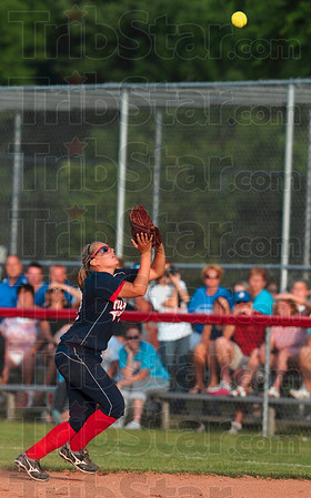 No problem: Terre Haute North's Hailee Travioli positions herself under a Jennings County pop fly during the Patriots' semistate win Saturday at the Center Grove semistate.