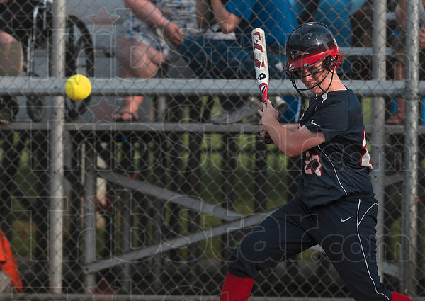 Tribune-Star/Joseph C. Garza<br /> Base hit: Terre Haute North's Alisha Ludwig gets a hit off of a pitch by Jennings County's Leah Kemmerer during the Patriots' win at the Center Grove semistate Saturday.