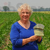 Inspired: Diane Mann holds one of her ceramic corn cribs. She incorporates the vanishing farm structure in many of her works.