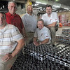 Team Coca Cola: The team includes (from left) Warehouse Manager Brian Cole, Sales Center Manager Stanley Delauter, Merchandising Supervisor Dave Jozwiak, Field Service Supervisor Dugan King and Distribution Supervisor Randy Hayne.