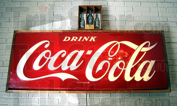 Detail: Coca Cola sign located in the lobby of the company's office on Lafayette Avenue.