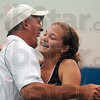 "Tribune-Star/Joseph C. Garza<br /> Way to go, No. 1 ""dubs"": Terre Haute South No. 1 doubles player Mallory Metheny receives a hug from coach Bill Blankenbaker after she and her teammate, Emma Bilyeu, won their state tennis semifinal match against Columbus North Saturday in Indianapolis."