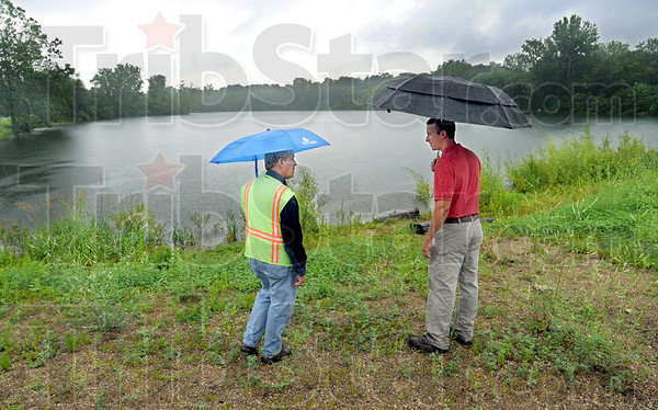 Plan this: City planner Pat Martin (L) and staff engineer Marcus Mauer discuss the plan for the 23 acre site at US 41 and Maple Avenue Wednesday morning. The finished product will be called the Maple Street Pond Park.