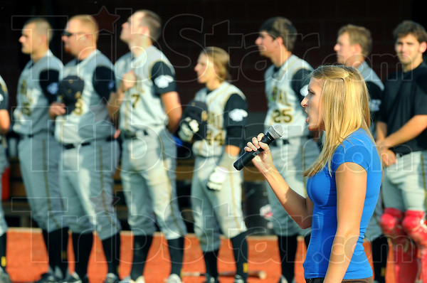 Local talent: Adriane Wunderlich. graduate of Terre Haute South High School and Indiana State University sings the National Anthem before the Rex-Hannibal game Wednesday evening.