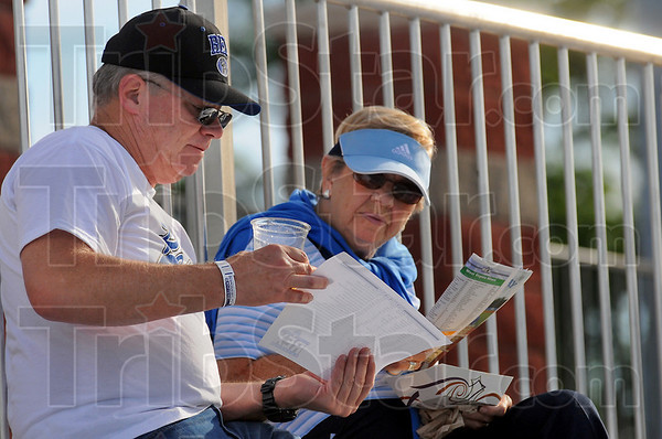 Mom's night out: Dave Giltner and his mother Geri look over the rosters before the Rex's game with the Hannibal Cavemen Wednesday evening.