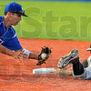 Too fast: Rex shortstop Ray Hernandez can't put the tag on base stealing Caveman Jerry Hildreth in early game action Wednesday evening at Bob Warn Field.