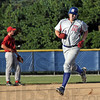 Round tripper: A.J. Reed heads for third base after hitting a long home run to left center field during game action against Post 108 of St. Bernice.