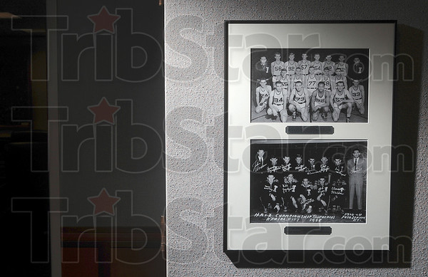 Tribune-Star/Joseph C. Garza<br /> The groundbreaking Indiana State Teachers College: A two photo display in Parsons Hall commemorates the first racially integrated collegiate men's basketball team to play in a post season tournament which was coached by the legendary John Wooden at Indiana State Teachers College in 1947-48.