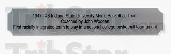 Tribune-Star/Joseph C. Garza<br /> A first at Indiana State Teachers College: This small plaque in the display in Parsons Hall on the Indiana State campus explains the significance of the 1947-48 men's basketball team.