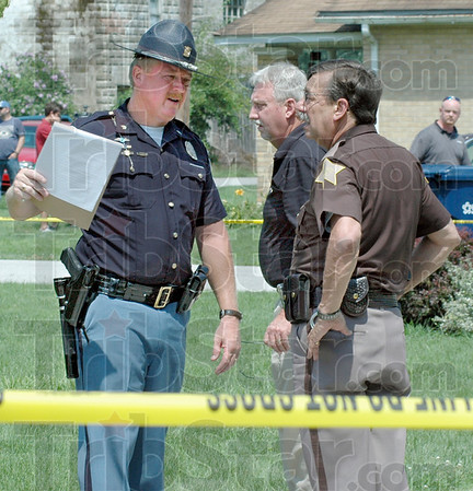 On the spot: Indiana State Police Sgt. Joe Watts (L) talks with Vigo County Sheriff Jon Marvel about his actions upon arrival at the scene of an attempted kidnapping in Prairie Creek Wednesday afternoon. Watts was in the general area of the event and arrived quickly after the 911 dispatch to make an arrest of the subject with the help of an off-duty Terre Haute police officer.