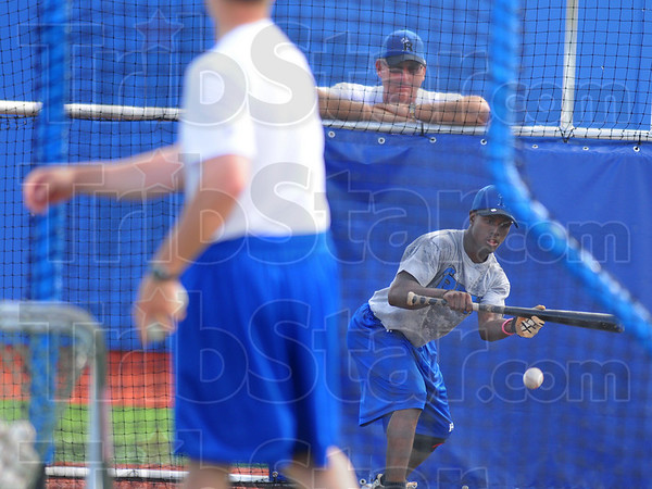 Overseer: Rex Manager Brian Dorsett watches newest Rex player Derrick Daniels tap bunts in the batting cage Wednesday evening.
