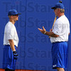 BP: Rex manager Brian Dorsett, right, talks with Koby Kramer during practice Wednesday.