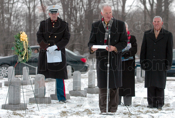 Tribune-Star file photo/Joseph C. Garza<br /> Honoring a life of service: Dr. David Behrs, former president of St. Mary-of-the-Woods College, recites an Irish prayer as he remembers the late Sister Catherine Hartman during a ceremony in Memorial Cemetery of the Sisters of Providence Jan. 29.