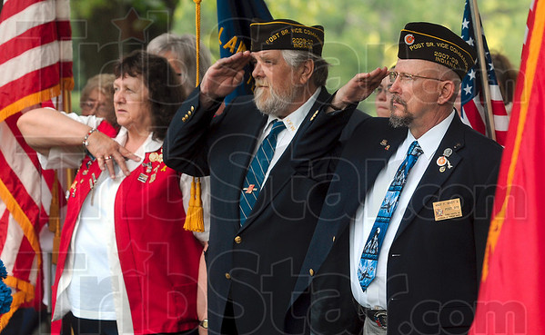 Tribune-Star/Joseph C. Garza<br /> Taps salute: Marlene Deerwester, VFW Post 972 auxiliary president, Richard Spence, post vice commander, and Andy Whitt, post commander, render salutes as Taps is played at Highland Lawn Cemetery Monday during a Memorial Day ceremony.