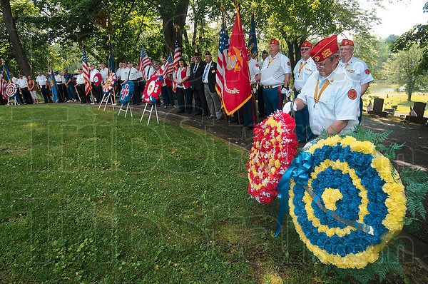 Tribune-Star/Joseph C. Garza<br /> For the ones who gave all: Archie Steadman, commandant of the Joseph A. Bray Marine Corps League Detachment 471, places a wreath on the grass at Highland Lawn Cemetery along with other veterans organizations Monday during a Memorial Day ceremony.