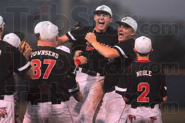 "Tribune-Star/Joseph C. Garza<br /> No. 12 gets the ""W"": Brent Mulvihill, center, celebrates with his teammates, including fellow pitcher Andrew Reed, after the Braves defeated Terre Haute North to win the No. 13 sectional Monday at North."