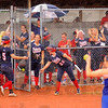 Back home again: Danielle Ketner(5) is welcomed back to the Patriot dugout by Amber Maffioli(22) and other teammates after scoring the tieing run in the 4th innning of their state championship game with Hamilton Southeastern.