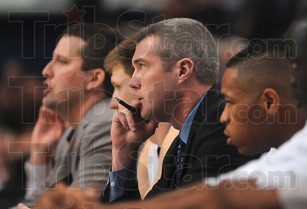 Tribune-Star/Joseph C. Garza<br /> Watching the Xs and Os: Indiana State menÕs basketball Associate Head Coach Greg Lansing watches the Sycamore offense against Missouri State Feb. 27 at Hulman Center.